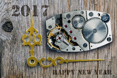 Der Uhrmechanismus, Pfeile von Stunden und das neue Jahr Stockbilder