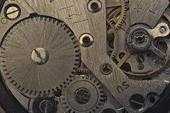 Der Uhrmechanismus von alten Uhren Stockbilder