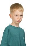 Der verärgerte Junge. Stockfotografie