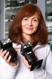 Der Verkäufer der Fototechnik Stockfoto
