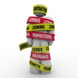 Der Vertrag von den Lizenzen, die Inspektion in Zonen aufteilen, kodiert Erbauer Wrapped Tie Lizenzfreie Stockfotografie