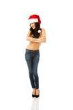 Der in voller Länge hemdloser tragender Sankt-Hut Frau Stockfoto