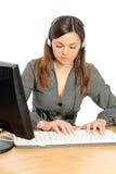 Der weibliche Repräsentant des Services des Klienten Stockfotografie