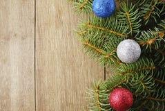 Der Weihnachtshintergrund Lizenzfreie Stockfotos