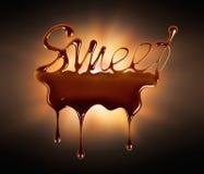 Der Wort Bonbon geschrieben mit geschmolzener Schokolade lizenzfreies stockbild
