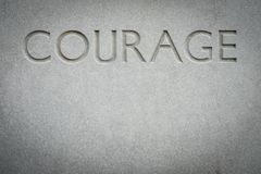 Der Wort-Mut graviert in Felsen stockfoto