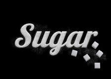 Der Wort Zucker geschrieben durch Zuckerkörner stockfoto