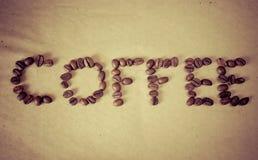 Der Wortkaffee von den Bohnen Stockfoto
