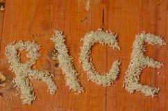 Der Wortreis gemacht vom Reis Reis, reis, arroz, riso, riz, риÑ- Lizenzfreies Stockbild