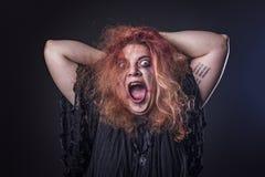 Deranged woman screaming Stock Photo