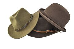 A derby or bowler, and two outback style hats isolated on white Stock Photo
