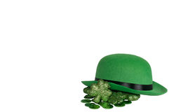 Derby hat on white with shamrocks and coins. St. Patrick's Day background Royalty Free Stock Photo