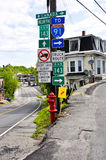 Derby Line signpost. This road sign in the tiny village of Derby Line, VT marks the border between the US and Canada. Go left, and you will be in Canada, go Royalty Free Stock Photos