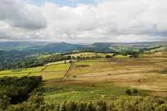 Derbyshire Fields and Hillsides. Derbyshire Countryside on a Sunny Day showing the relatively small fields with stone walls Royalty Free Stock Image