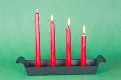 Derde van Komst met rode kaarsen Stock Foto