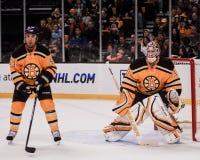 Derek Morris und Tim Thomas, Boston Bruins Lizenzfreie Stockfotografie