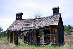 Derelict 1900's Barn in Oregon. Horizontal image of a derelict 1900's barn in ruins, in Oregon, USA Royalty Free Stock Photography