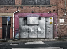 Derelict abandoned commercial property awaiting demolition Stock Image