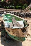 Derelict Balinese canoe on the beach royalty free stock photography
