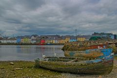 Derelict boats. And colourful houses at Connemara in Ireland Royalty Free Stock Photography