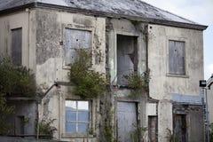 Derelict building in Carmarthen, Carmarthenshire, Wales, United. A derelict building in Carmarthen, Carmarthenshire, Wales, United Kingdom.  There are plants Royalty Free Stock Photos