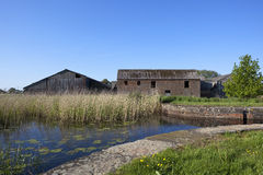 Derelict canal with barns Stock Photography