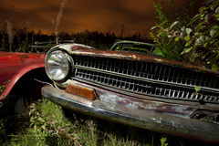 Derelict car at night Royalty Free Stock Image