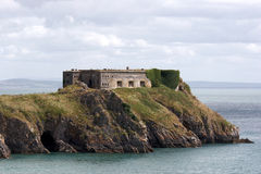 Derelict castle on an island in Pembrokeshire Stock Photos