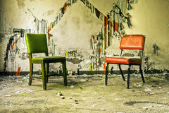 Derelict Chairs in Abandoned Building Royalty Free Stock Photography