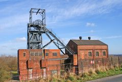 Derelict Coal Mine. Image of an abandoned pit head winding gear in the old Yorkshire Coal Field, Barnsley, UK Stock Photo