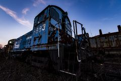 Derelict Conrail Locomotives at Sunset - Abandoned Railroad Trains royalty free stock photo