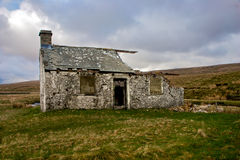 Derelict Cottage on Moors. Crumbling derelict cottage on the rolling hills on the Yorkshire Moors Stock Image