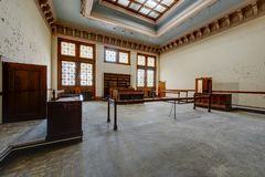 Derelict Courtroom - Abandoned Courthouse, Massachusetts. A view of a derelict courtroom with classical styling at an abandoned courthouse in Massachusetts Stock Photography