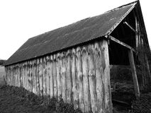 Derelict wooden farm barn shot in black and white vintage grainy film style stock photography