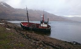 Derelict disused fishing boat in scotland Stock Images