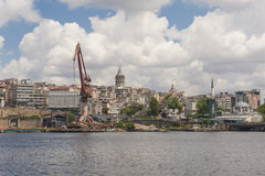 Derelict dockyard by river in city Royalty Free Stock Images