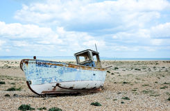 Derelict fishing boat on the beach Stock Images