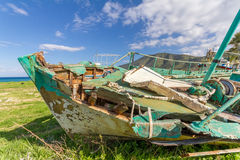 Derelict Fishing Boat out of sea in afternoon light in  Pomos harbor Stock Image