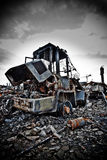 Derelict forklift truck. Closeup of derelict fire damaged forklift truck on waste dump Stock Photography