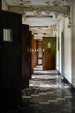 Derelict Hallway with Open Doors - Abandoned Hospital stock image