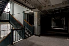 Derelict Hallway & Staircase - Abandoned Stambaugh Building - Youngstown, Ohio stock image
