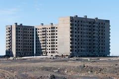 Derelict high-rise building in Norilsk. Stock Photos