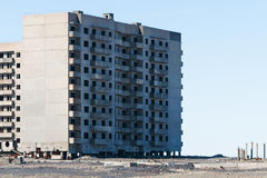 Derelict high-rise building in Norilsk. Royalty Free Stock Photos