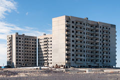 Derelict high-rise building in Norilsk. Stock Photo