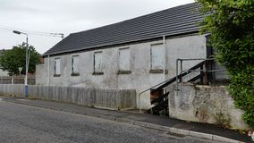 Derelict homes. Old abandoned homes boarded up Stock Image