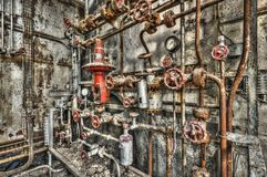 Derelict industrial boiler room in a disused factory. HDR processing Stock Photography
