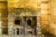Derelict interior, fireplace Stock Photo