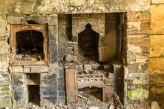 Derelict interior, fireplace Stock Photos