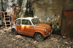Derelict Mini Car Wall Stock Photo