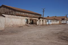 Derelict mining town in the Atacama Desert, Chile. Derelict nitrate mining town of Pedro de Valdivia in the Atacama Desert of northern Chile Royalty Free Stock Image